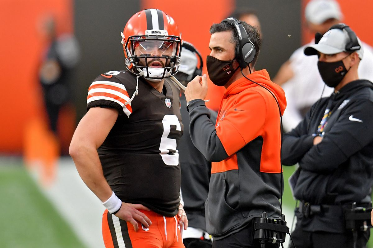 Baker Mayfield #6 of the Cleveland Browns meets with head coach Kevin Stefanski in the second quarter against the Indianapolis Colts at FirstEnergy Stadium on October 11, 2020 in Cleveland, Ohio.