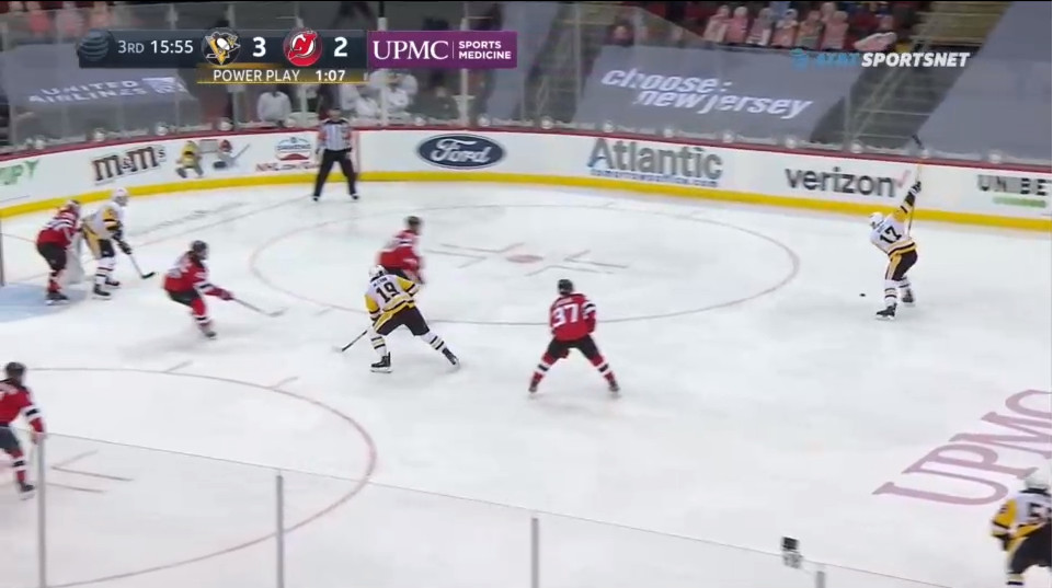 """April 9: The play was on the nearside of the camera until Pittsburgh changed the point of attack to Rust. Just as the Devils turned their heads, this slapshot would go. By the way, that's 5'11"""" Guentzel screening Blackwood - also uncovered."""