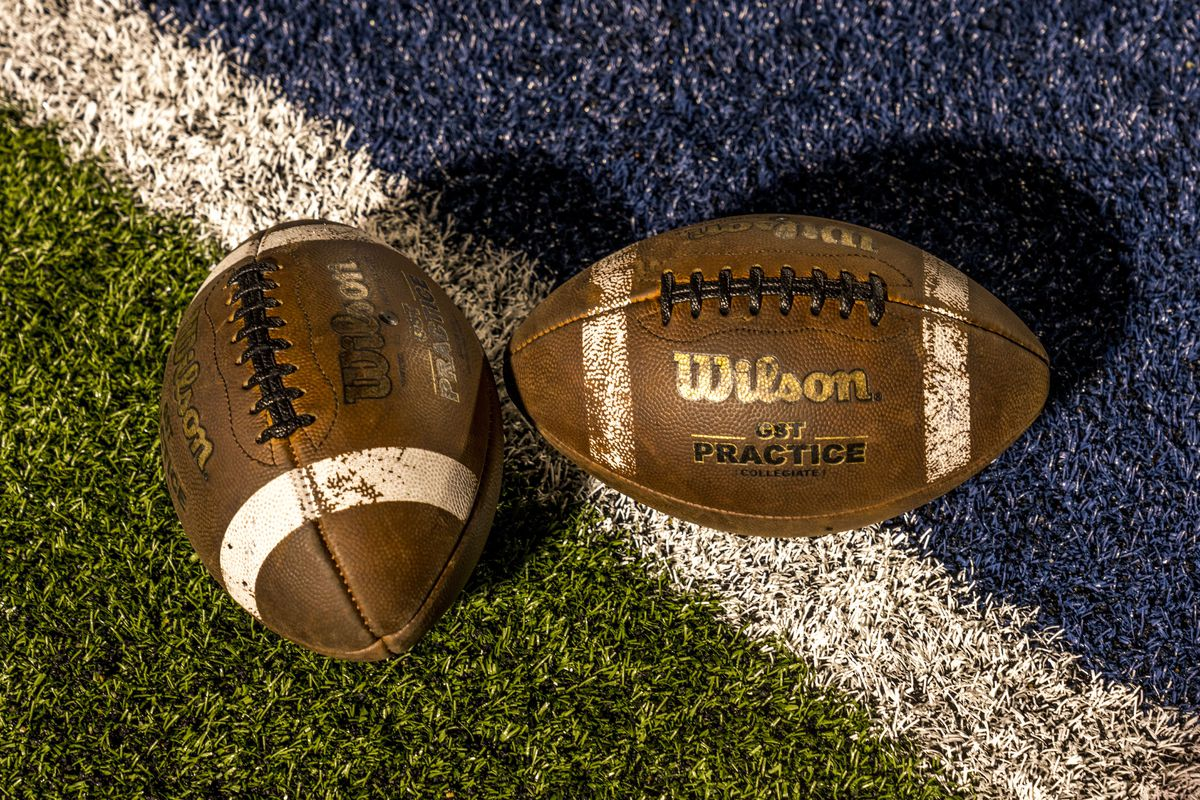 two footballs on field, Paris Texas Wildcats defeat Celina, Bobcats 54-7 in High School Division 4 Football Game