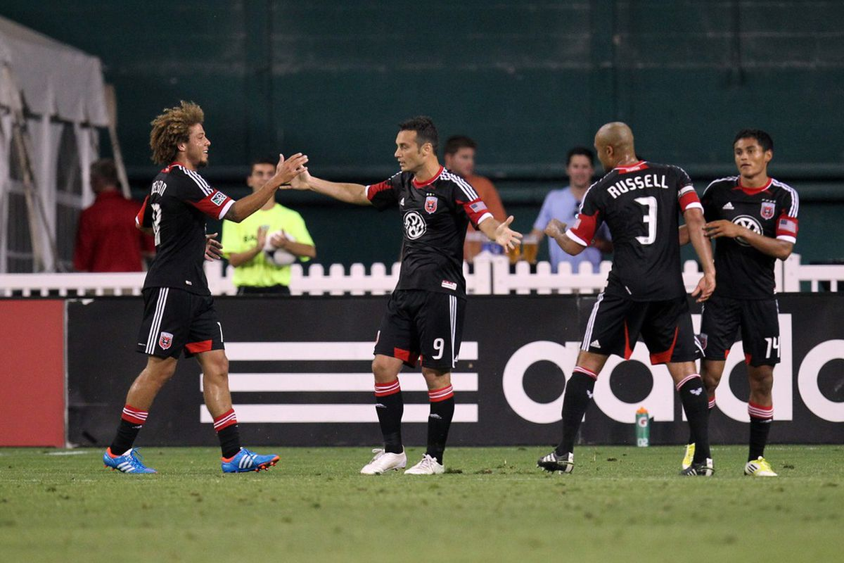 WASHINGTON, DC - JUNE 30: Hamdi Salihi #9 of D.C. United celebrates with teammates after his goal against the Montreal Impact at RFK Stadium on June 30, 2012 in Washington, DC.(Photo by Ned Dishman/Getty Images)