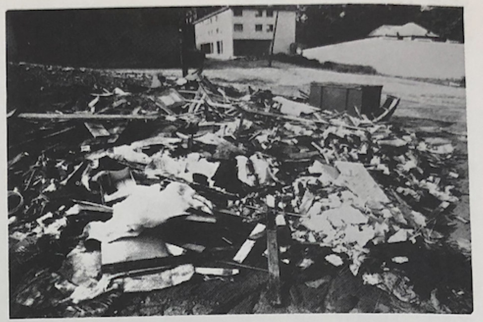 A black and white photo of a trash heap.