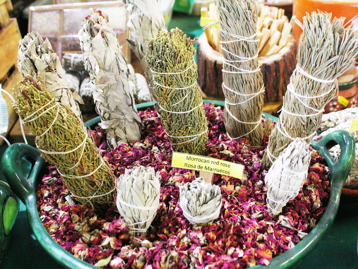 bundles of dried sage tied with string for sale at a farmer's market