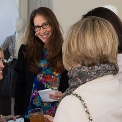 Jessica Mullens, who helped organize the event, chatting with guests