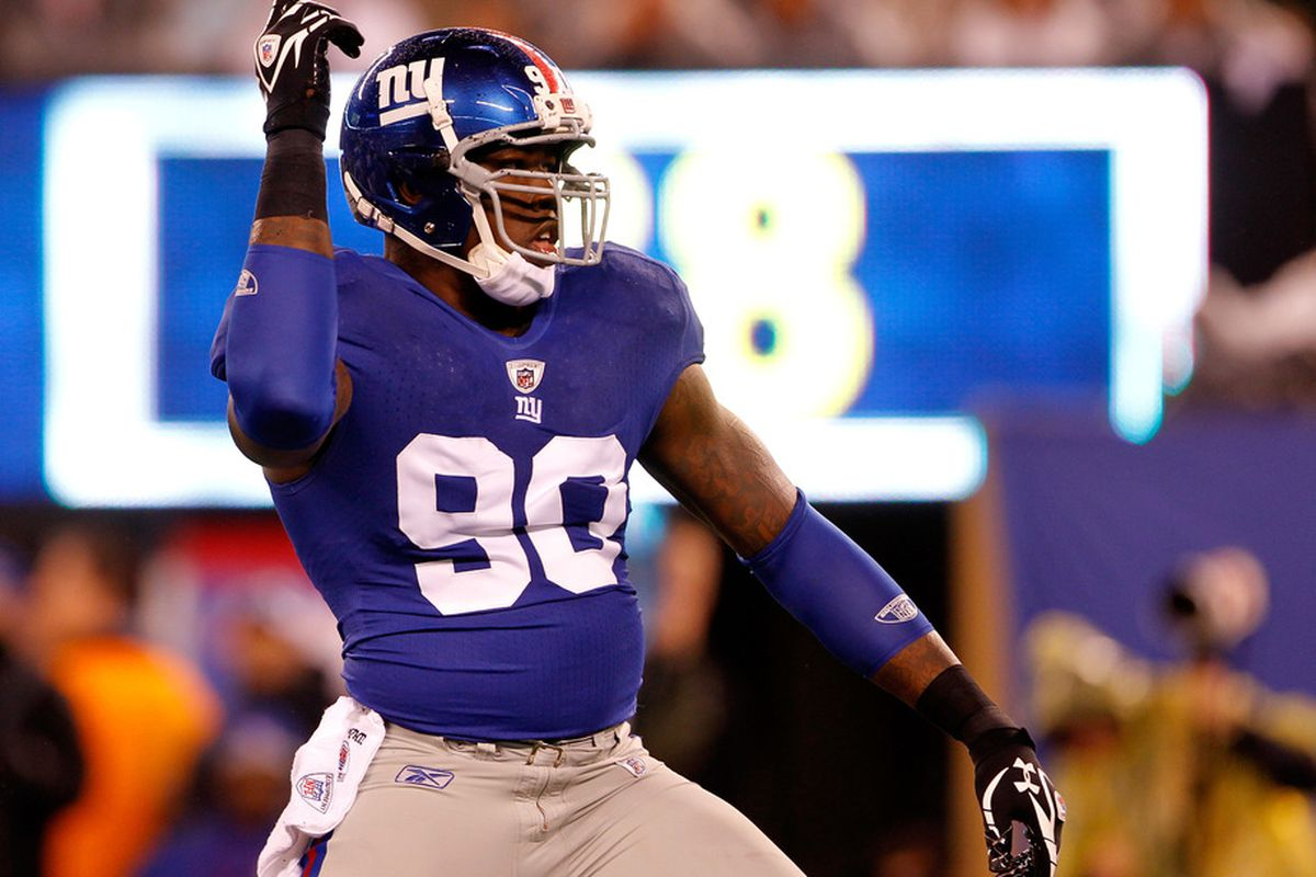 Jason Pierre-Paul of the New York Giants reacts after a sack in the first quarter against the Dallas Cowboys at MetLife Stadium on January 1, 2012 in East Rutherford, New Jersey.  (Photo by Rich Schultz/Getty Images)