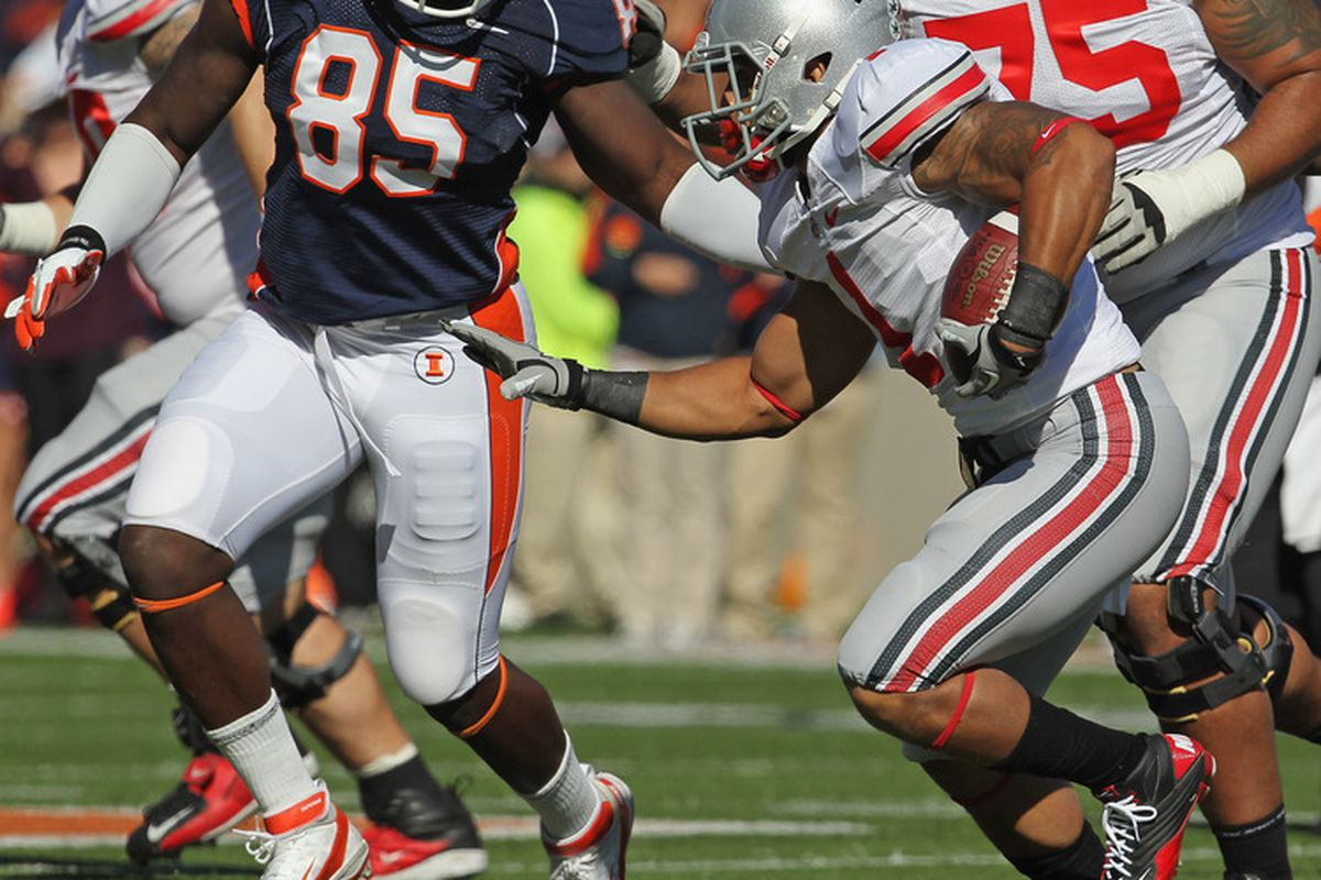 CHAMPAIGN, IL - OCTOBER 15: Dan Herron #1 of the Ohio State Buckeyes runs as Whitney Mercilus #85 of the Illiunois Fighting Illini gives chase at Memorial Stadium on October 15, 2011 in Champaign, Illinois. (Photo by Jonathan Daniel/Getty Images)