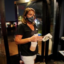 Kelly Petersen, co-owner of The Royal in Murray, cleans surfaces around the bar on Friday, May 22, 2020.