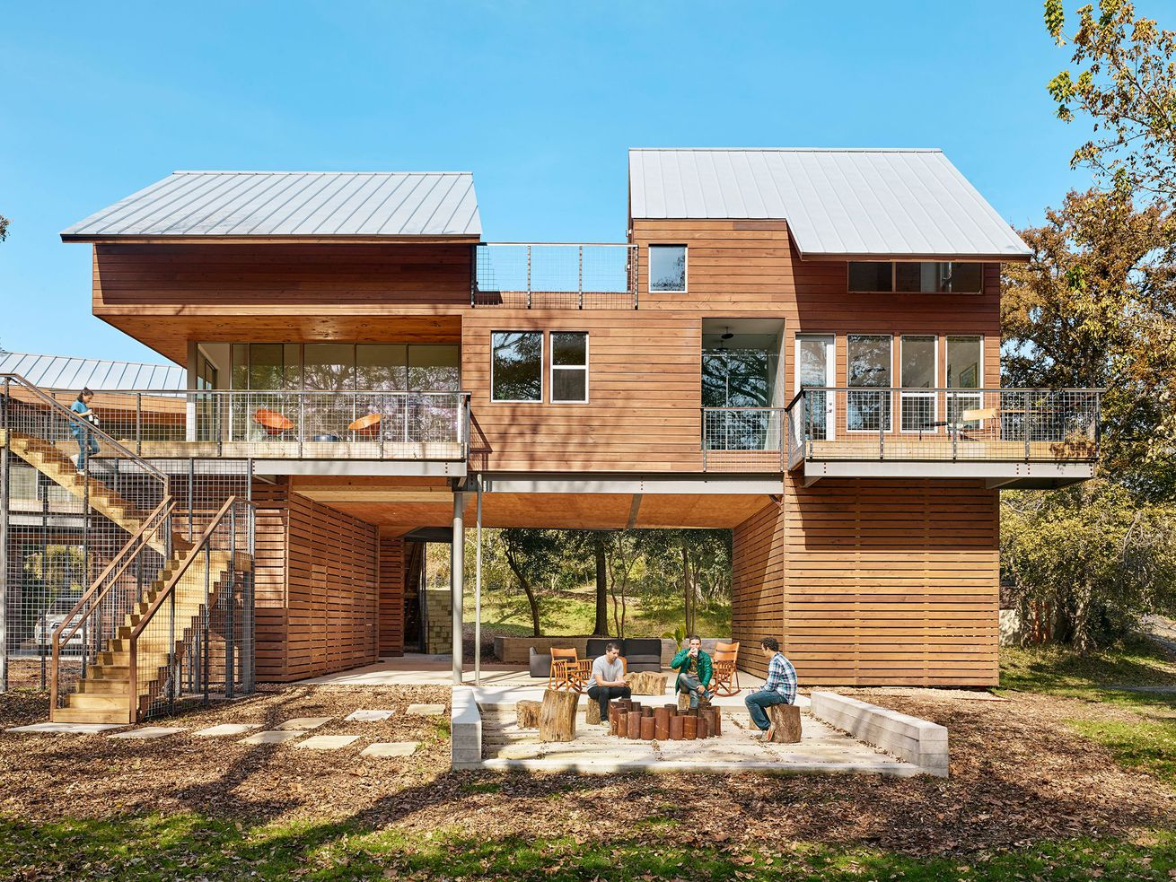 Timber house with large deck and outdoor seating area.