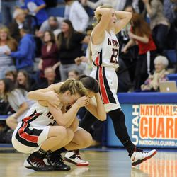 Alta's Rachel Jenson (5) is comforted after falling to American Fork during the state semi-finals at Salt Lake Community College on Friday, Feb. 28, 2014.