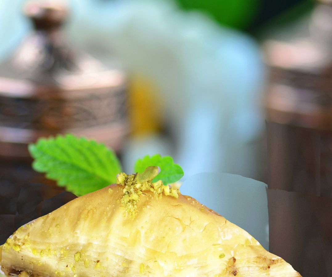 A close-up photo of a yellow piece of baklava from Jerusalem Restaurant