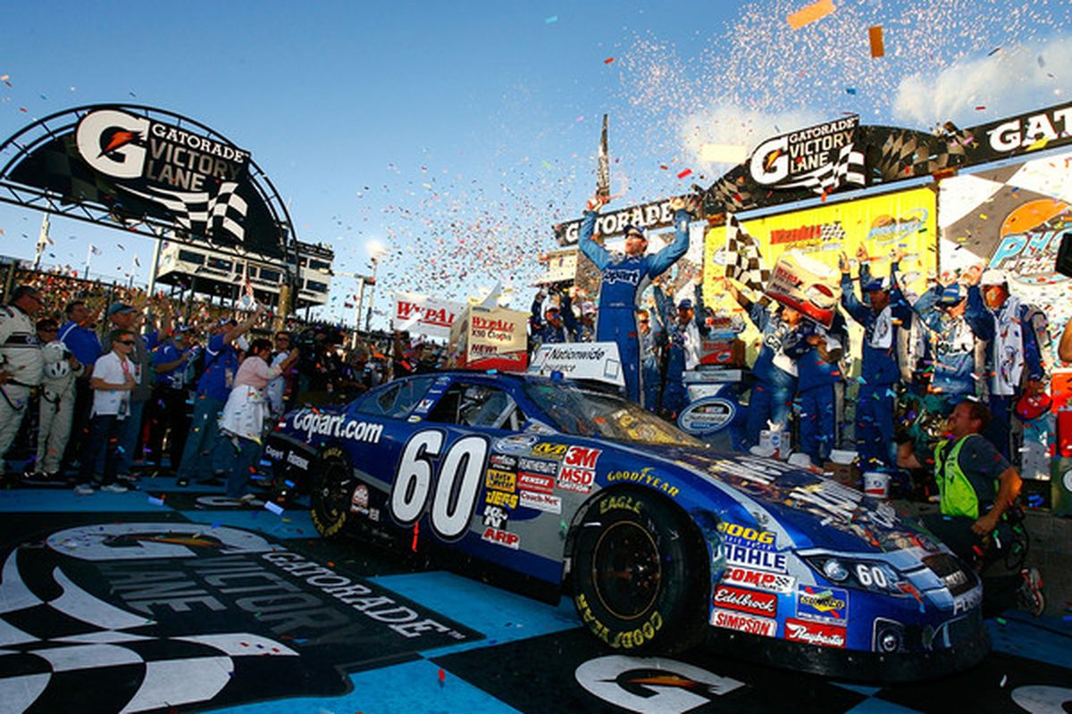 AVONDALE AZ - NOVEMBER 13:  Carl Edwards driver of the #60 Copart Ford celebrates winning the NASCAR Nationwide Series WYPALL 200 at Phoenix International Raceway on November 13 2010 in Avondale Arizona.  (Photo by Jason Smith/Getty Images)