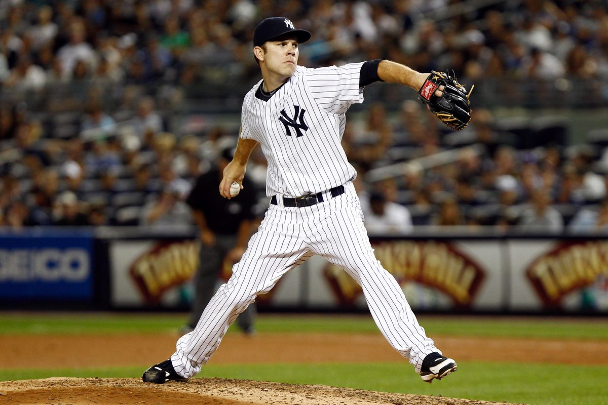 July 28, 2012; Bronx, NY, USA; New York Yankees relief pitcher David Phelps (41) pitches against the Boston Red Sox during the seventh inning at Yankee Stadium. Red Sox won 8-6. Mandatory Credit: Debby Wong-US PRESSWIRE