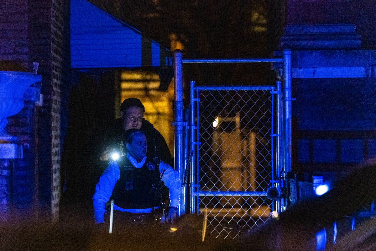 Chicago Police investigate the scene where a man was shot, Saturday night, in the 6200 block of South Rhodes, in the West Woodlawn neighborhood.   Tyler LaRiviere/Sun-Times
