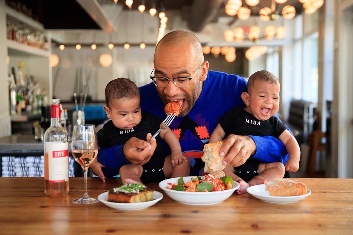 Douglass Williams of Mida with 4.5-month-old twins Raffa and Lev