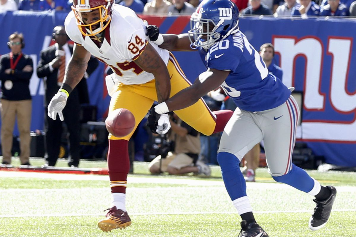 Prince Amukamra breaks up a pass in the end zone intended for Niles Paul on Sunday.