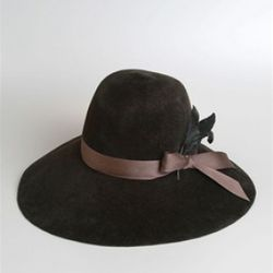 Cassidy Felt Hat with Feather Trim, Eugenia Kim, $341<br />Eugenia Kim hats are simply fabulous! This version features a wide brim with brown ribbon and feather trim. To die for!