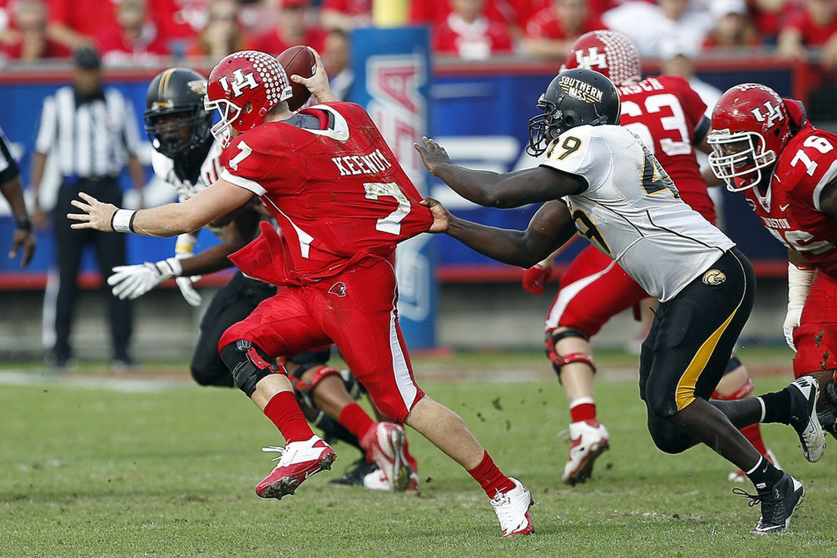 Quarterback Case Keenum #7 of the Houston Cougars is sacked by Cordarro Law #49 of the Southern Miss Golden Eagles.