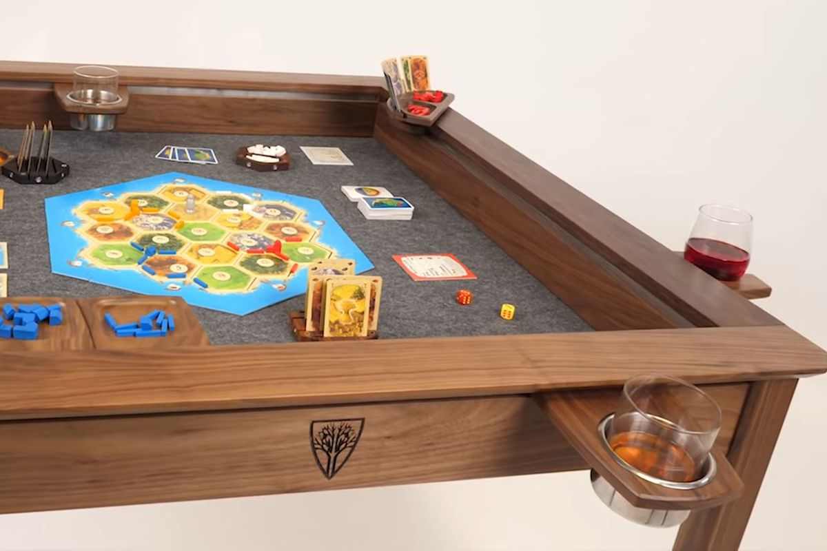 A Wyrmwood Modular Gaming Table, showing multiple accessories including cup holders and card holders.
