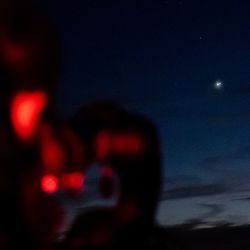 """Clark Allen prepares a telescope to view the """"Great Conjunction"""" of Saturn and Jupiter, visible in the center of the image, in the West Desert on Monday, Dec. 21, 2020. Also dubbed the Christmas Star, the conjunction is the closest together the two planets have passed in Earth's sky in nearly 400 years."""