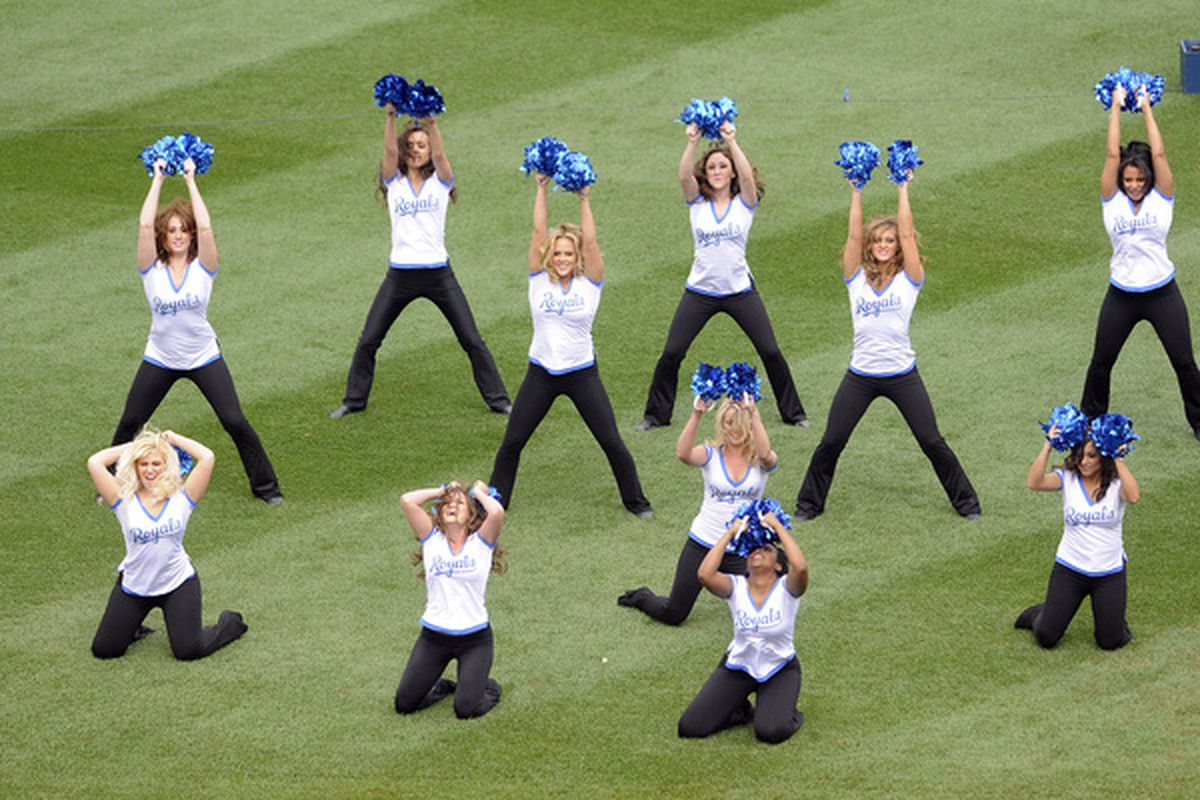 KANSAS CITY, MO - APRIL 05:  Royals dance girls during pre-game festivities present the various emotional states experienced by fans during a Royals game. The front row is representing the bullpen. (Photo by G. Newman Lowrance/Getty Images)