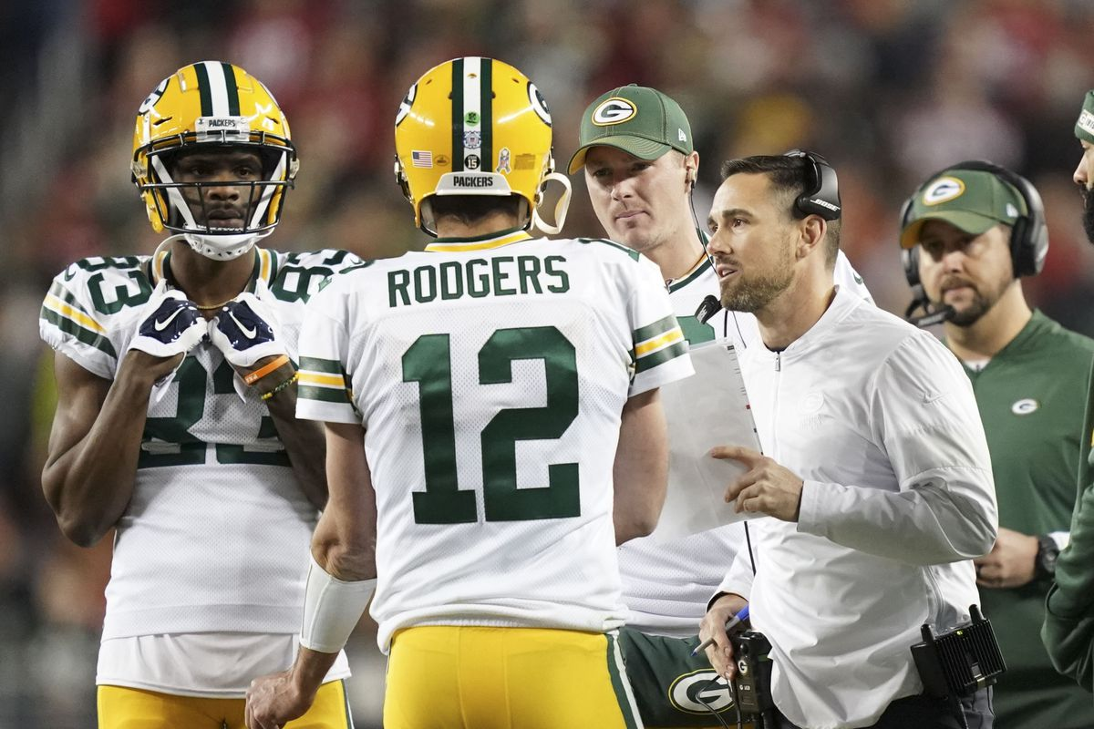 Green Bay Packers head coach Matt LaFleur talks to quarterback Aaron Rodgers against the San Francisco 49ers during the third quarter at Levi's Stadium.