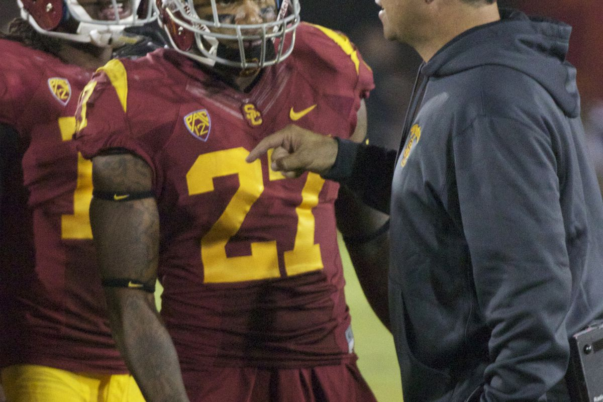 A fired-up Steve Sarkisian encourages his defense.