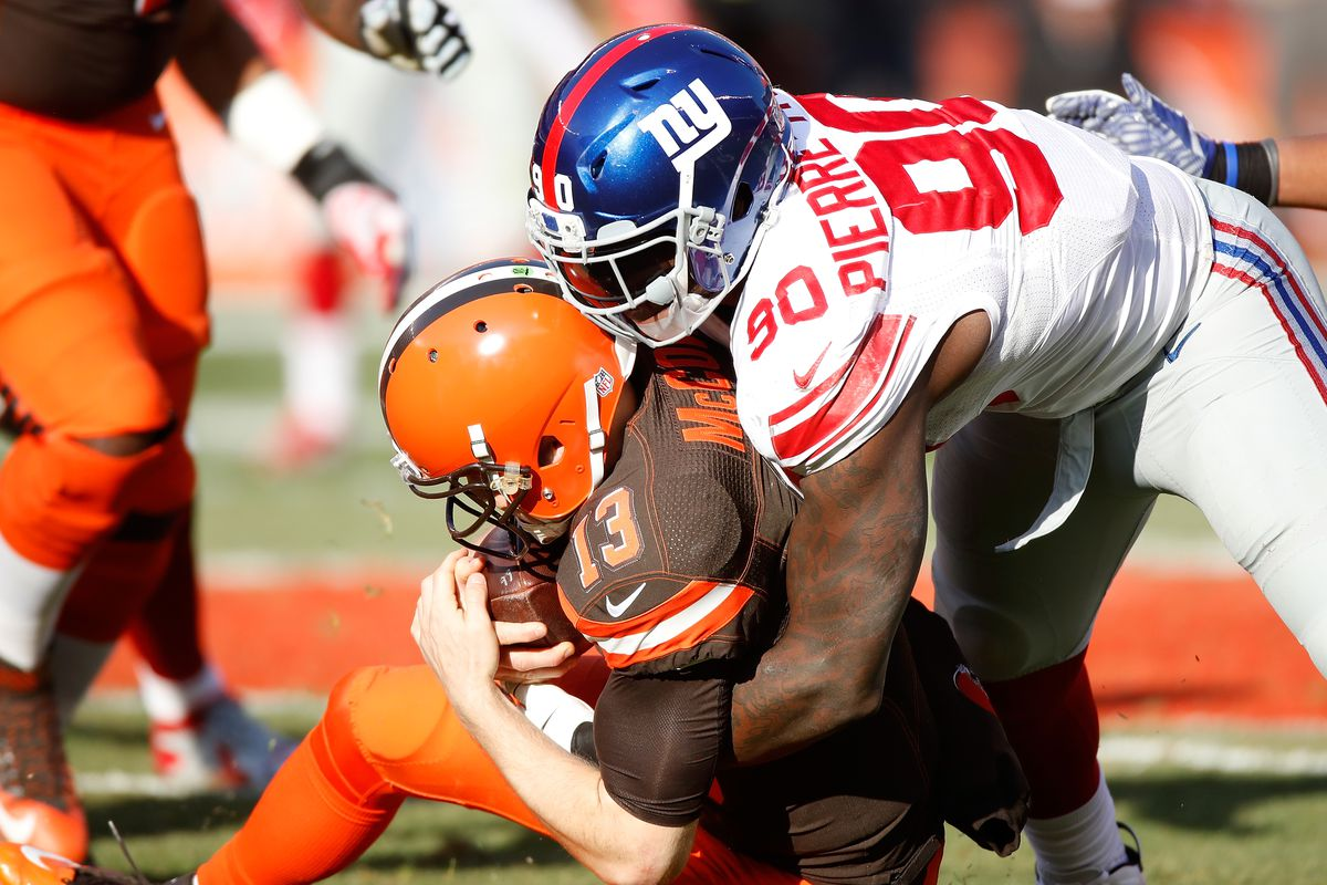 jason pierre paul with a sack against cleveland photo by gregory shamusgetty images