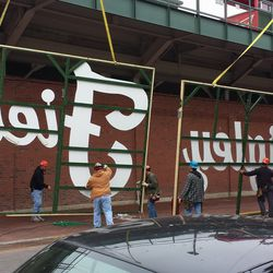 Beginning to raise the mock sign