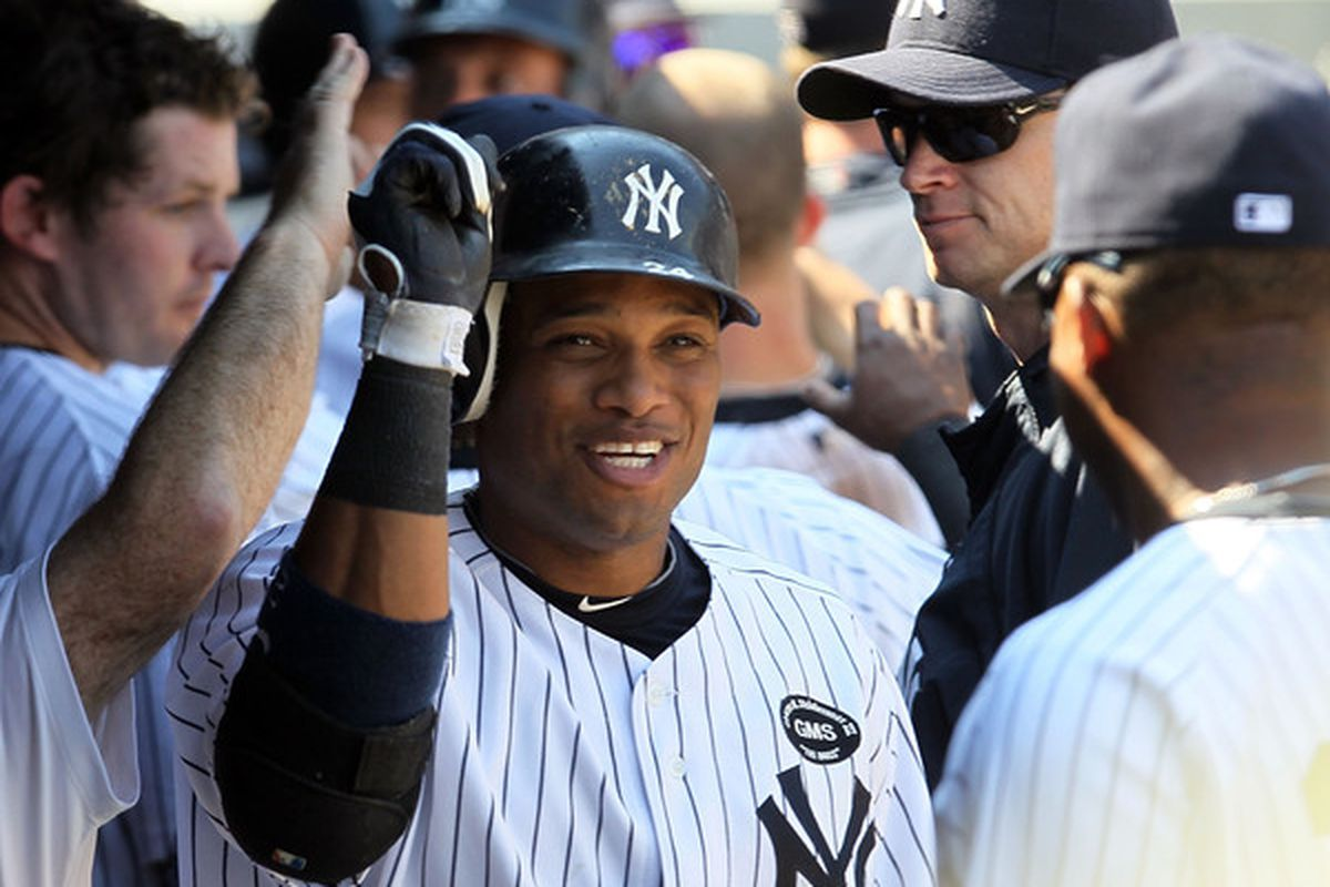 NEW YORK - AUGUST 19:  Robinson Cano #24 of the New York Yankees celebrates his sixth inning two run home run against the Detroit Tigers on August 19 2010 at Yankee Stadium in the Bronx borough of New York City.  (Photo by Jim McIsaac/Getty Images)