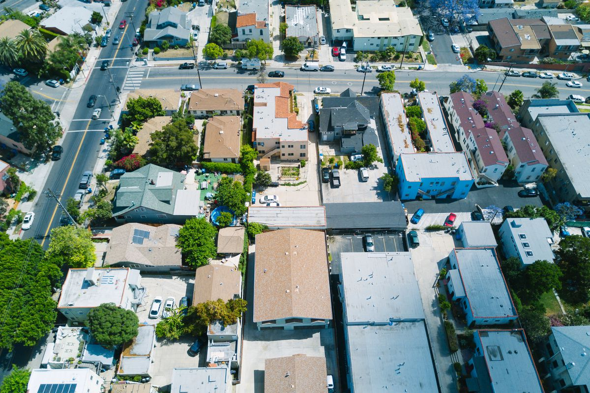 Aerial image of building rooftops in a residential neighborhood.