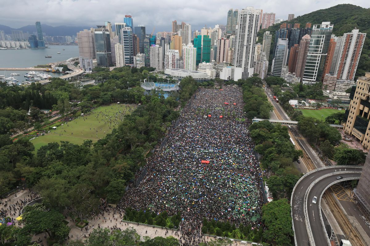 Protesters gather during a rally at Victoria Park in Hong Kong on Sunday, Aug. 18, 2019. Thousands of people streamed into a park in central Hong Kong on Sunday for what organizers hope will be a peaceful demonstration for democracy in the semi-autonomous