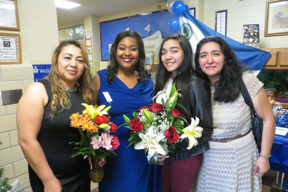 Principal Yolanda Heidelberg with former student Maria Pena (third from left) and family members.