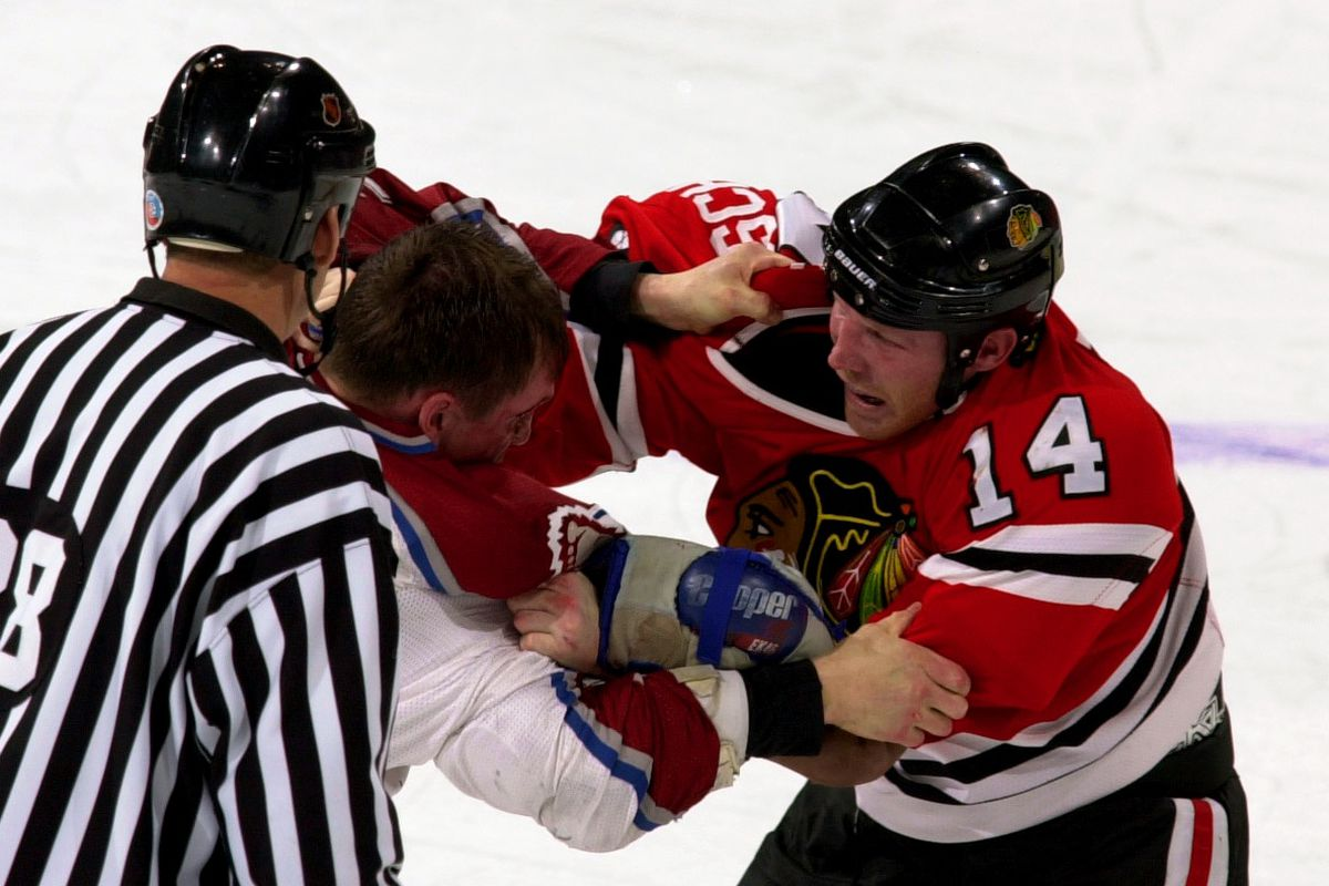 Colorado Avalanche Jeff Odgers gets into it with Chicago's #14 Ryan VandenBussche during the first period of action.