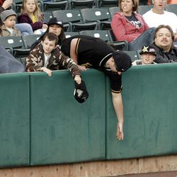 A fans just misses a grounder as the Salt Lake Bees open the season at home  in Salt Lake City  Friday, April 13, 2012.
