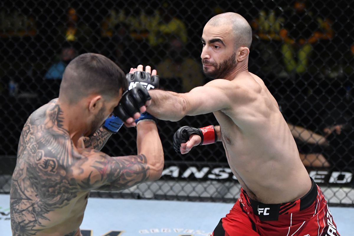 In this UFC handout, (R-L) Giga Chikadze of Georgia punches Cub Swanson in a featherweight bout during the UFC Fight Night event at UFC APEX on May 01, 2021 in Las Vegas, Nevada.