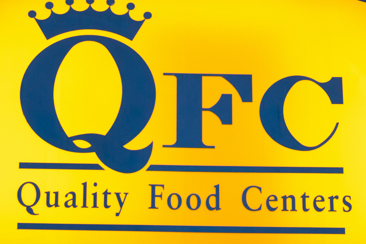 A yellow sign for QFC: Quality Food Centers