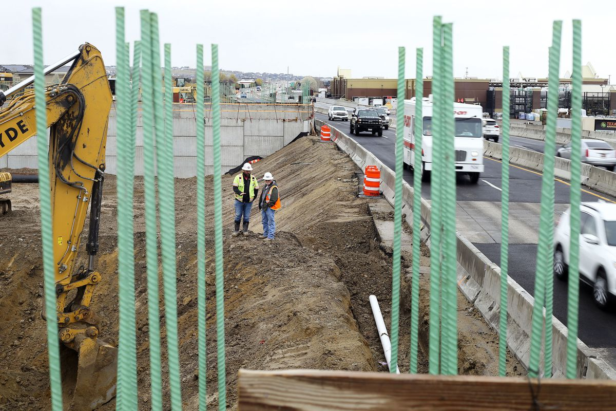 Traffic moves through the construction zone for the Bangerter Highway interchange at 12600 South in Riverton on Thursday, April 15, 2021. The Utah Department of Transportation will work on 185 projects in 2021, with a value of $3.45 billion over the life of the projects, many of which span multiple years.