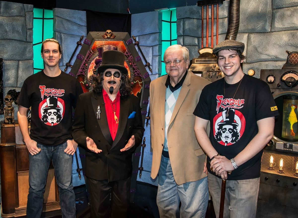 Zay Smith enjoyed an opportunity to take his son Bryant (far left) and Zachary to meet TV's Svengoolie, a fellow punster.