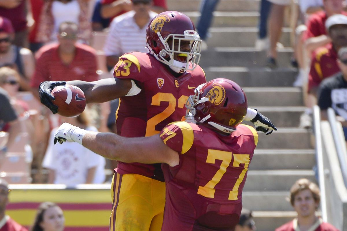 Kevin Graf (right) celebrates with running back Tre Madden (left) after a touchdown against Boston College