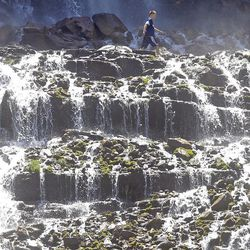 Bridal Veil Falls in Provo Canyon is shown in this Tuesday, May 30, 2017, photo. Brian McInerney of the National Weather Service says rivers are swelling and flowing briskly because snow runoff from mountain peaks is around double its normal amount in northern Utah.