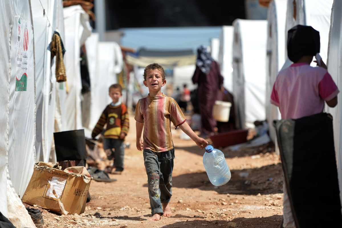 Internally displaced Syrian families at the Maiber al-Salam refugee camp along the Turkish border