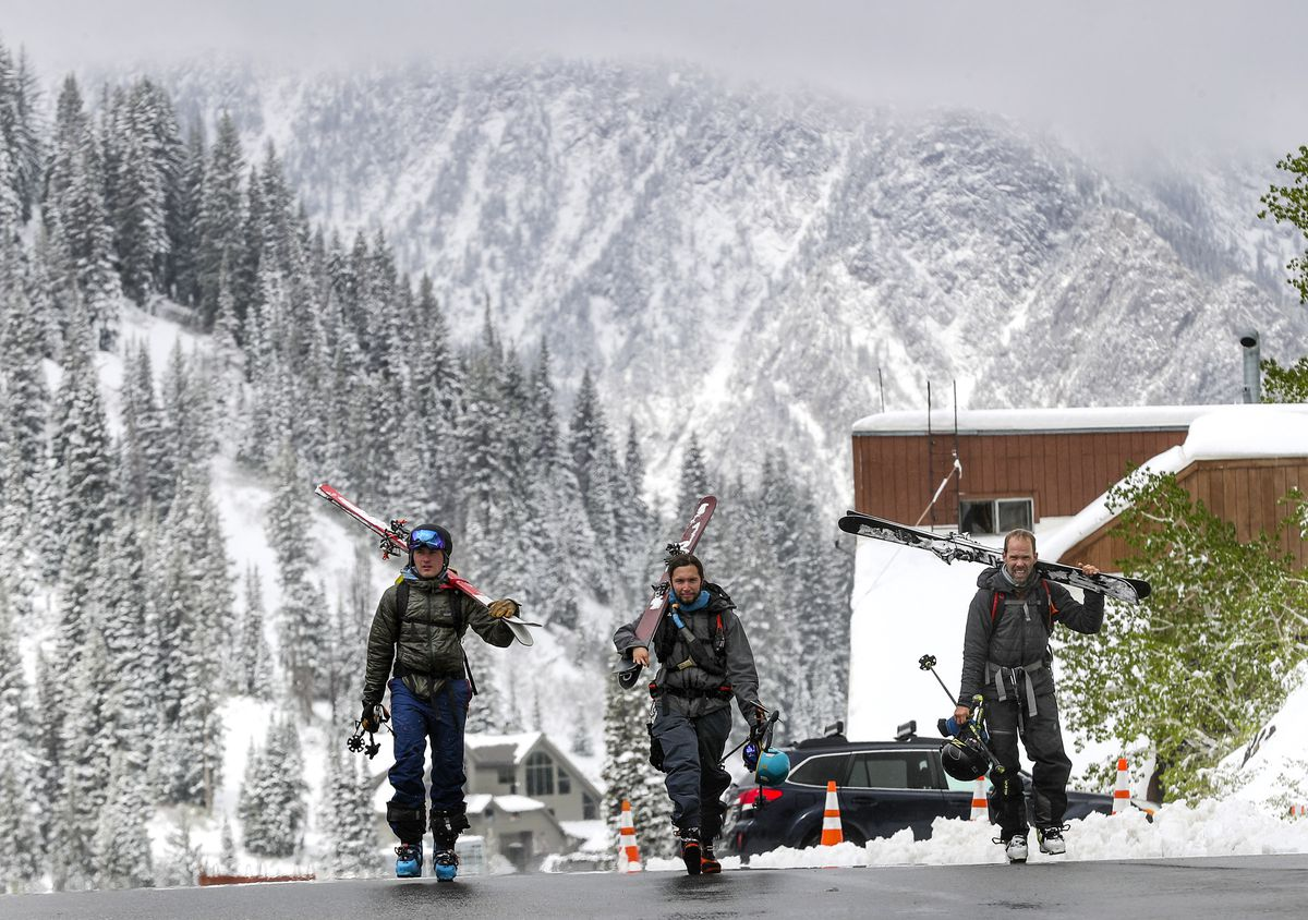 Backcountry skiers Jake Turnbull, left, Santiago Vega and Jason Malczyk walk back to their cars after skiing at Alta Ski Area at the top of Little Cottonwood Canyon on Monday, June 8, 2020.