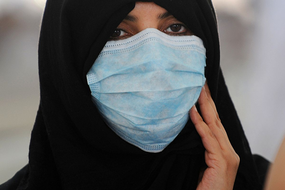 A religious pilgrim wears a mask because of fear of MERS. (October, 2013, near Mecca)