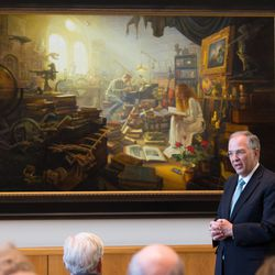 """Elder Neil L. Andersen of the LDS Church's Quorum of the Twelve Apostles spoke briefly at the unveiling of Greg Olsen's new painting """"Treasures of Knowledge."""" The painting will be displayed in the family room of the Gordon B. Hinckley Visitors and Alumni Center. The painting was commissioned by Leo and Annette Beus."""