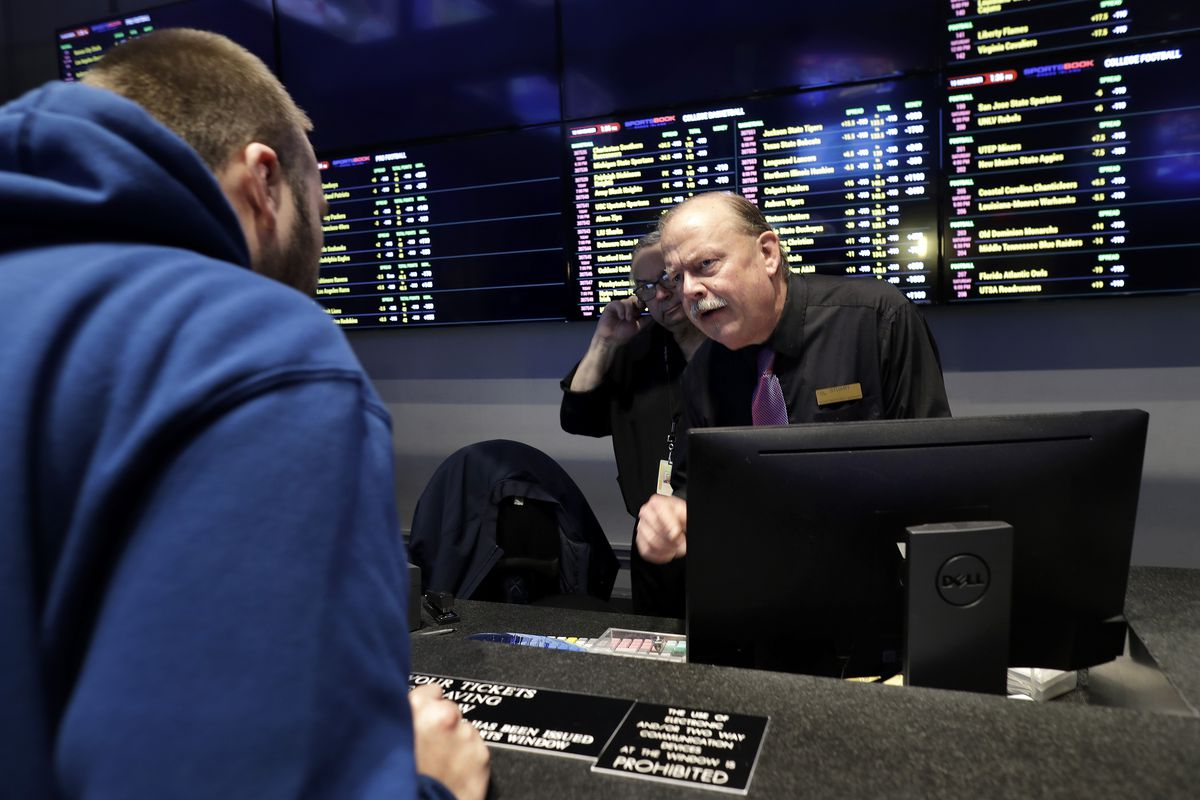 A gambler places a bet at a Rhode Island sportsbook last month.