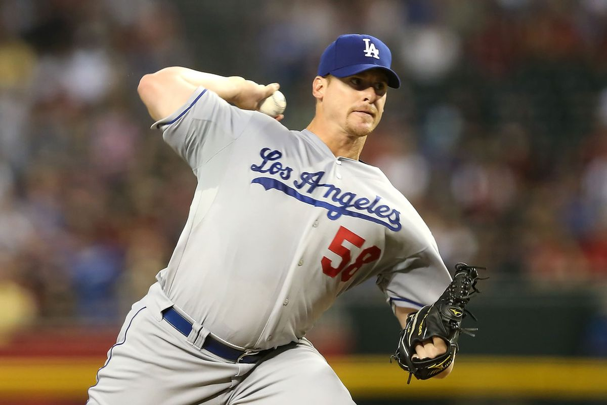 PHOENIX, AZ - JULY 07:  Starting pitcher Chad Billingsley #58 of the Los Angeles Dodgers pitches against the Arizona Diamondbacks during the MLB game at Chase Field on July 7, 2012 in Phoenix, Arizona.  (Photo by Christian Petersen/Getty Images)