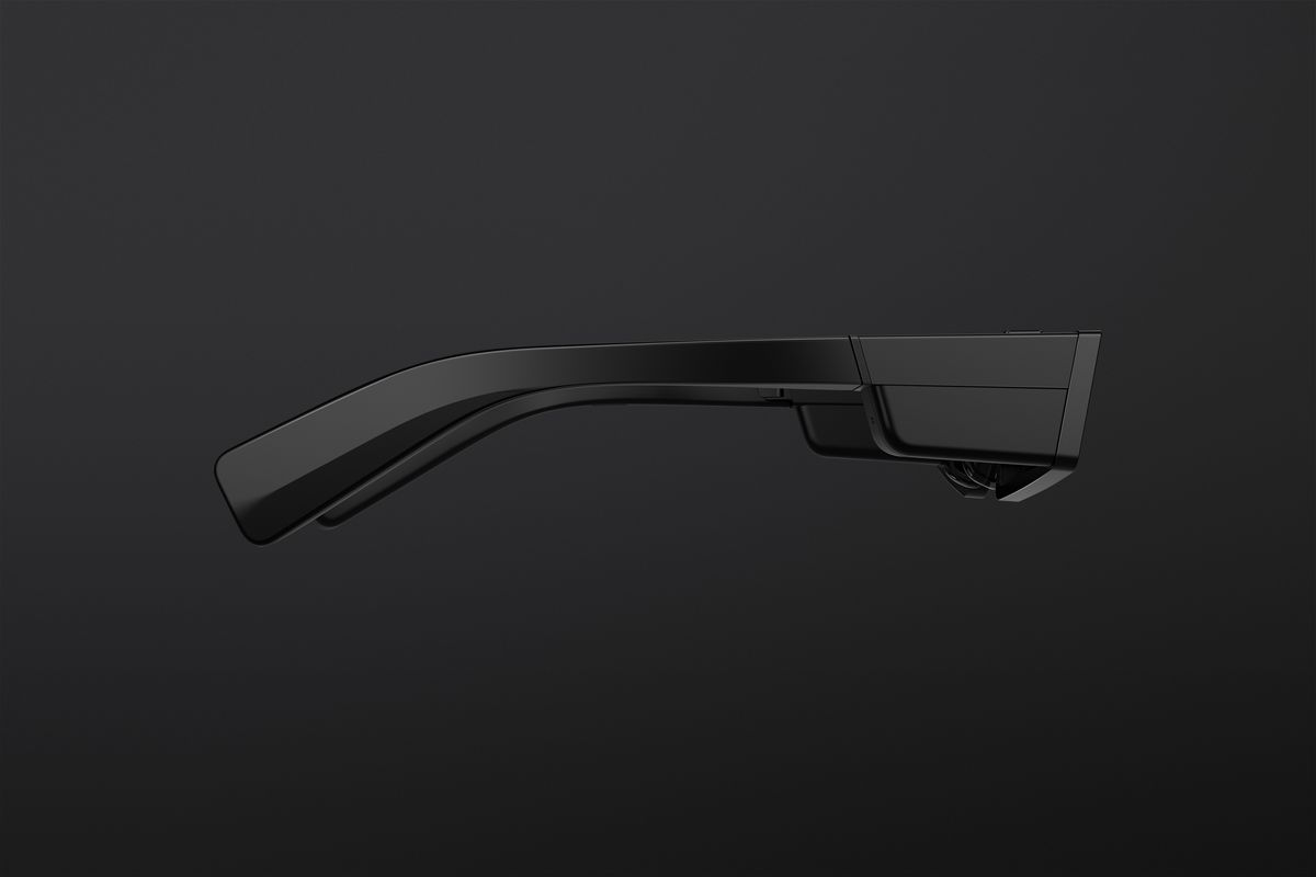 A side view showing the right temple of the glasses. A touchpad beside the lens lets you control the Spectacles.