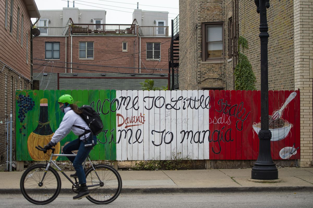 A cyclists rides down Taylor Street in Little Italy. | Tyler LaRiviere/Sun-Times