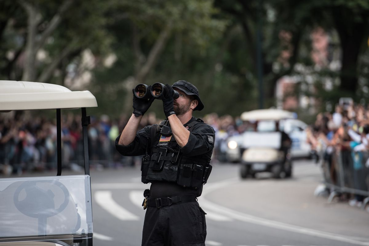 A member of the Secret Service checks rooftops before Pope Francis passes through Central Park on September 25, 2015, in New York.