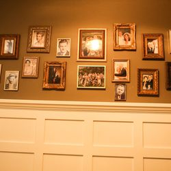Family photos line a wall in the Kirby family's home in Lehi on Thursday, Dec. 17, 2020.
