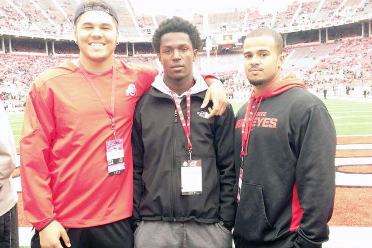 The Buckeyes offered 2017 DB Marcus Williamson (center) on Saturday.